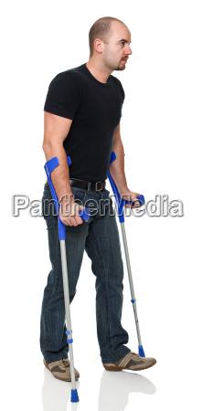man with crutch