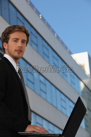 young businessman outside a modern office