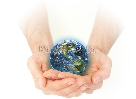 maskuline hand mit einem 3d planeten