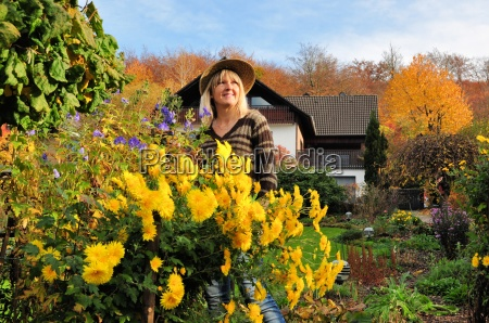 woman in autumnal garden