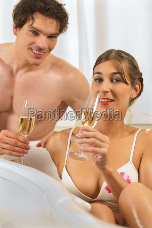 couple at spa with sparkling wine