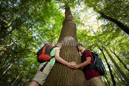 environmental conservation young hikers embracing large