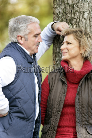 loving couple standing by a tree