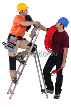 two electrician stood with step ladder