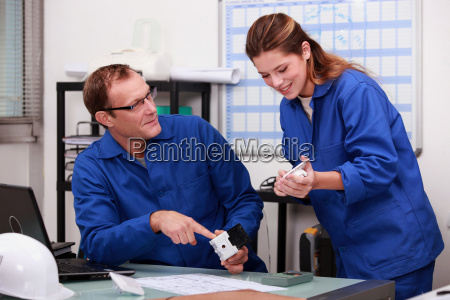 plumber and female apprentice in office