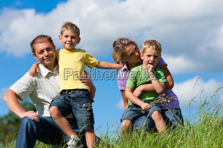 family with children on a lawn