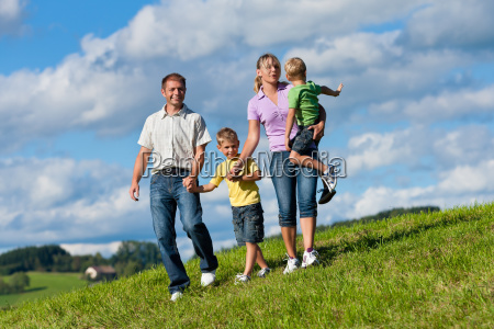 family with children on a meadow
