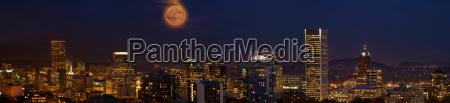 moon over portland oregon city skyline