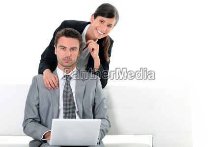 business couple looking at a laptop