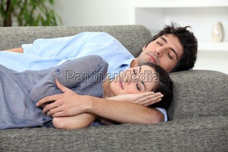 couple asleep on sofa