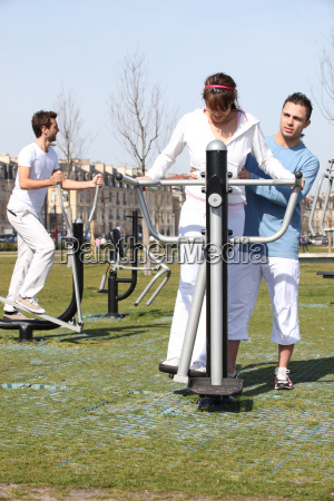 young people using an outdoor gym