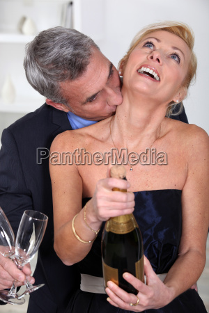 man kissing his wife039s neck