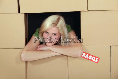 woman stood amongst cardboard boxes