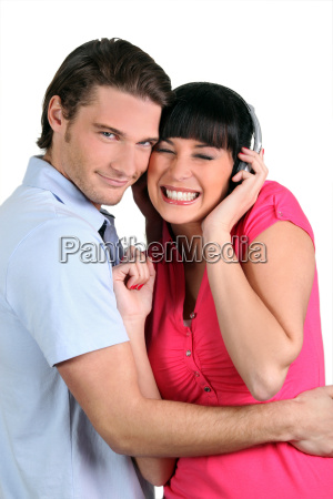 young couple listening to music on