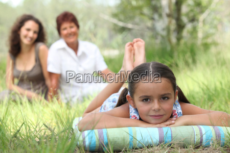 little girl relaxing in park with