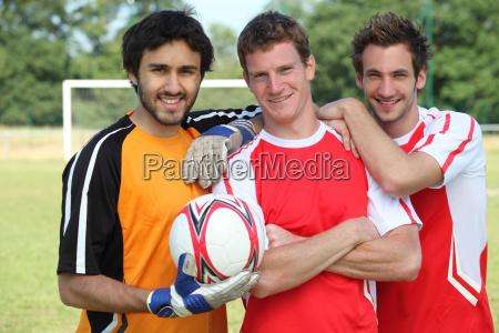 football teammates posing