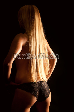 back view of a nude blond