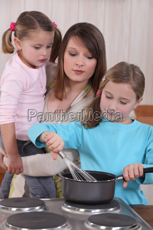 young woman and little girls preparing