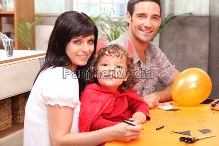 a family making halloween preparations