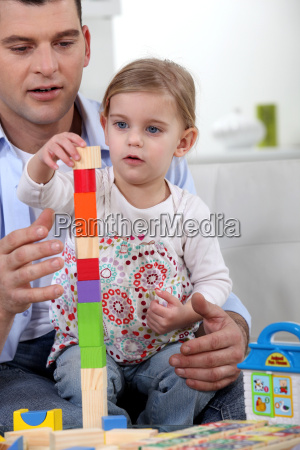 father and daughter with building blocks