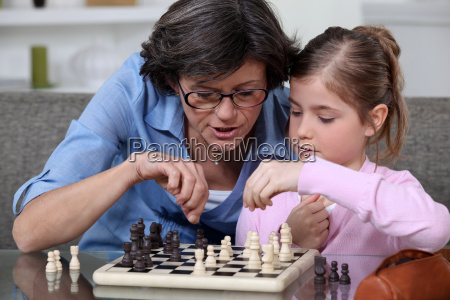 a mother teaching her daughter how
