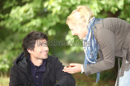 man and woman picking chestnuts in