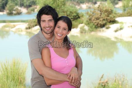 couple stood by lake