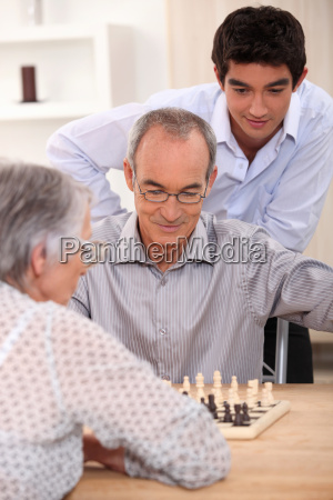 young man watching an older couple