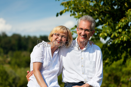 happy elderly couple taking a walk