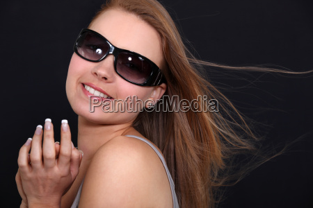 pretty smiling girl with sunglasses against