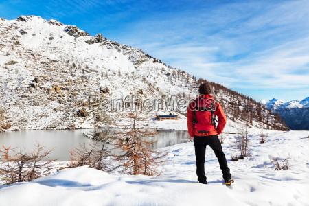 hiker winter mountain lake