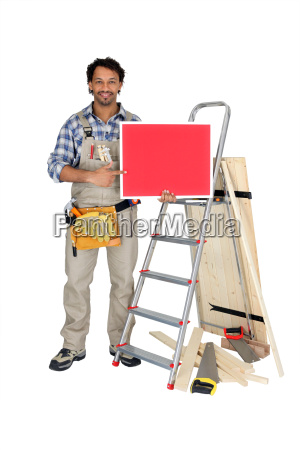 carpenter holding red sign