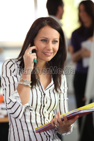 woman on the phone holding office