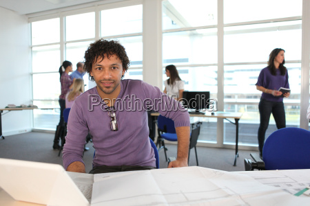 young man in architect039s office with