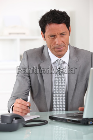 male executive at laptop