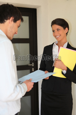 smart woman giving contract to a
