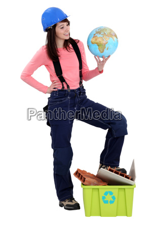 young female builder holding globe