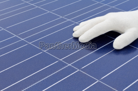 hand with white glove before solar