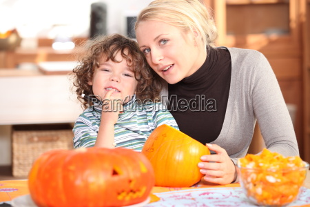 mother and child carving pumpkins