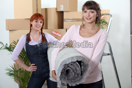 two girlfriends moving in their new
