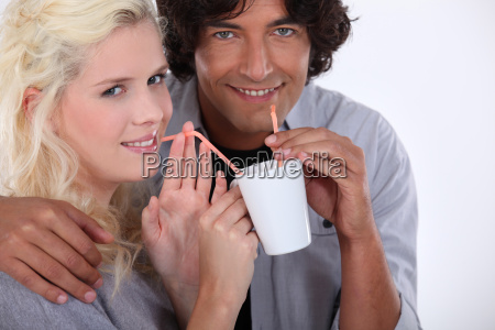 couple drinking from the same cup