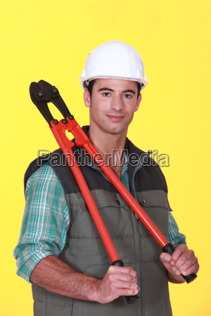 a construction worker holding pliers