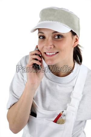 female decorator on the telephone
