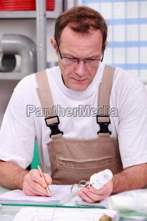 craftsman in his office describing a