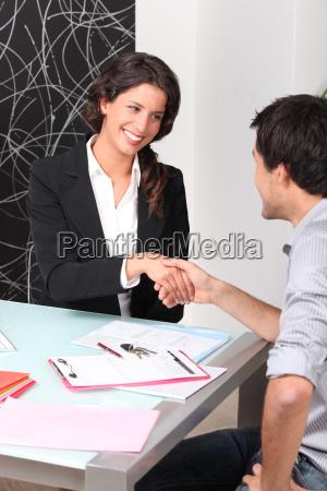 cheerful woman and man handshaking