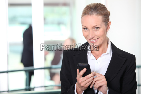 smiling businesswoman with a mobile phone