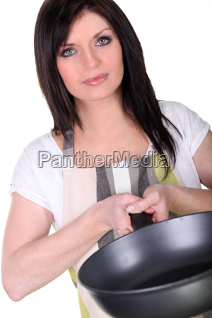 woman with a saucepan
