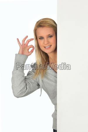 young woman giving the okay sign