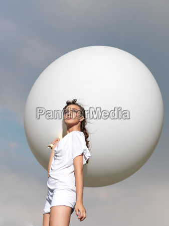 happy young woman standing with white