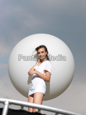 young woman on trampoline with white